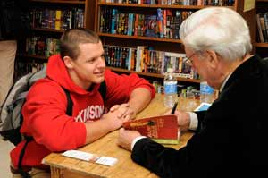 Ben Hargrave, a student of Spanish Literature, with Mario Vargas Llosa during the book-signing. Photograph by Pierce Bounds
